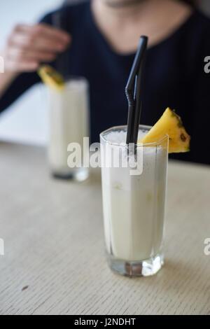 Two glasses of pina colada - Stock Photo