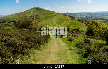 People walking on the Malvern Hills in Worcestershire, enjoying the spring sunshine. - Stock Photo