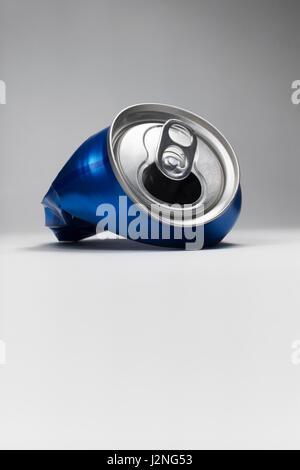 Blue aluminum crushed soda can. - Stock Photo