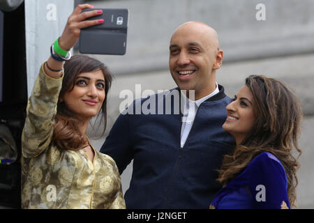 London, UK. 29th April 2017. A woman takes a selfie with TV and radio presenter Tommy Sandhu and radio presenter - Stock Photo