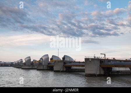 Woolwich, London, UK. 30th April 2017. UK Weather: Sunny intervals and cloud at dawn over London Thames barrier. - Stock Photo