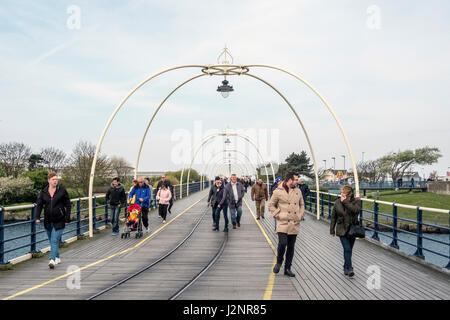 Southport, Merseyside, 30th April. UK Weather.  Despite the windy and cloudy conditions, bank holiday daytrippers - Stock Photo