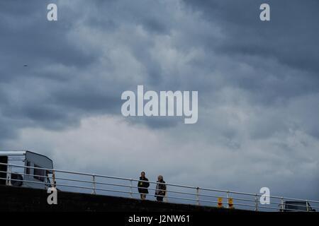 Aberystwyth Wales UK. Sunday 30 April 2017  Dark stormy rain clouds forming over the Cardigan Bay sea at Aberystwyth - Stock Photo
