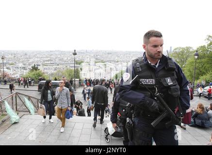 Paris, France. 30th Apr, 2017. French policemen patrol at the Basiique du Sacré-Coeur in Montmartre on April 30, 2017 in Paris, France. Credit: VWPics/Alamy Live News