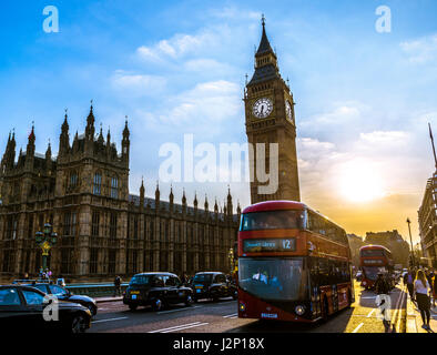 Red double decker bus in front of Big Ben, Houses of Parliament, backlit, evening light, City of Westminster, London - Stock Photo