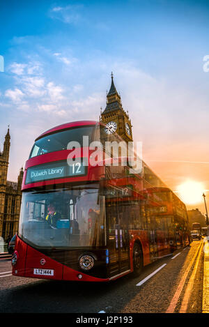 Red double decker bus in front of Big Ben, Houses of Parliament, backlit, Sunset, City of Westminster, London, London - Stock Photo