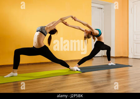 Two athletes doing stretching exercises - Stock Photo