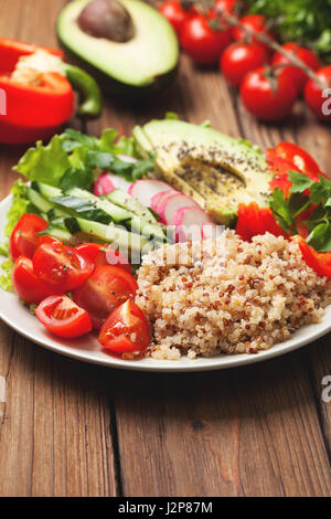 buddha bowl with mixture of vegetables, quinoa  on wooden background - Stock Photo