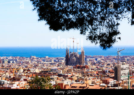 Gaudi's La Sagrada Familia basillica and Barcelona skyline from Park Guell, Barcelona, Catalunya, Spain - Stock Photo