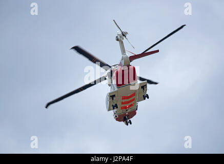 Coastguard helicopter departing from home base at Inverness Airport on call out. - Stock Photo