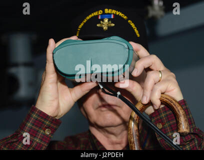 Retired U.S. Army 1st Sgt. Claude Quick, Legion of Valor member, looks through simulation binoculars at the Maritime - Stock Photo
