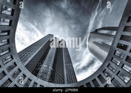 Wide angle monochrome image of Tower 185, Frankfurt, Germany, Europe,  with reflections on the Pollux skyscraper - Stock Photo