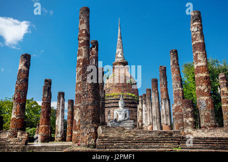 Ancient White Buddha and Stupa surround by ruined column in Wat Sa Si of Sukhothai Historical Park, Thailand - Stock Photo