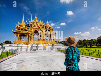 Woman in hat and green checked with photo camera looking at the Ananta Samakhom Throne Hall in Thai Royal Dusit - Stock Photo