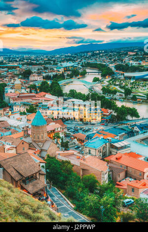 The Top View Of Old Colorful Town And Kura Mtkvari River Under Bridges In Summer Tbilisi, Georgia Beautiful Scenic - Stock Photo