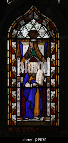 Stained Glass Window depicting Moses with the Ten Commandments Tablet of Stone - Stock Photo