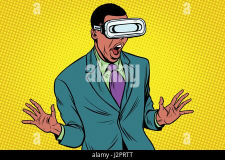 Shocked African American in VR glasses - Stock Photo