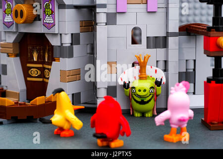 Tambov, Russian Federation - July 20, 2016 Lego King Pig gives up to Angry Birds - Red, Stella and Chuck near King - Stock Photo