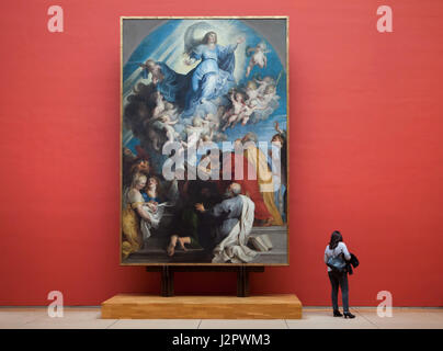 Visitor in front of the painting 'Assumption of Mary' by Flemish painter Peter Paul Rubens and his workshop (ca. - Stock Photo