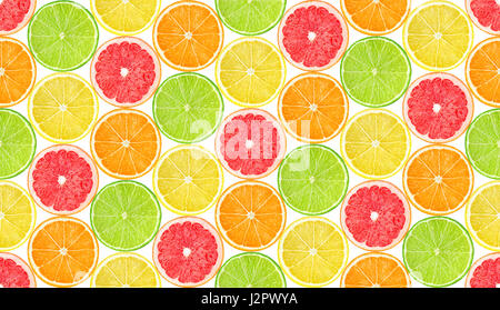 Citrus fruits pattern. Seamless background with slices of orange, lemon, grapefruit and lime fruits isolated on - Stock Photo
