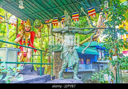 UNAWATUNA, SRI LANKA, DECEMBER 4, 2016: The statues of Hindu Monkey-headed God Hanuman and Rama with bow and arrows - Stock Photo
