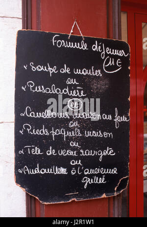 Charming rustic handwritten two course restaurant 'menu of the day', on blackboard South of France Sanary-sur-Mer, - Stock Photo