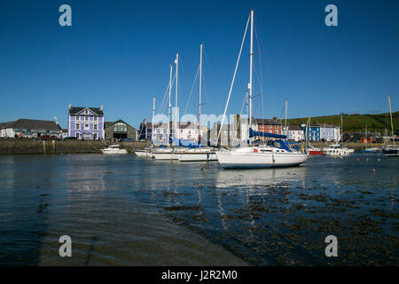 Aberaeron - a charming Georgian port town on the Cardigan Bay coast of West Wales. Yachts and motor Boats anchored - Stock Photo