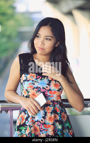 Thoughtful Asian woman reflects - Stock Photo