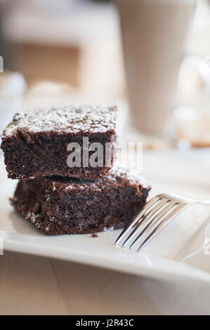 Food Two Chocolate Brownies Dessert Pudding Sweet Treat Chocolate brownies Baked Baking Fork Plate - Stock Photo