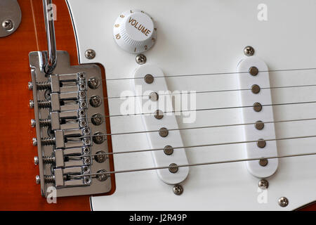 Macro of electric guitar strings and single pickup and pickguards - Stock Photo