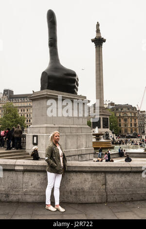 'Thumbs up' for David Shrigley's giant bronze Thumb on the Fourth Plinth in London's Trafalgar Square. - Stock Photo