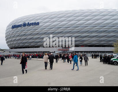 Munich, Germany - 22 April 2017: Football fans are entering the Allianz Arena football stadium in Munich, Germany. - Stock Photo