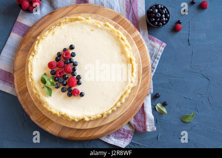 Homemade cheesecake with fresh berries and mint for dessert - healthy organic summer dessert pie cheesecake. Cheese - Stock Photo