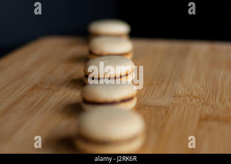 Macaroons organized in straight line - Stock Photo