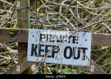 Warning signs on a gate - Stock Photo