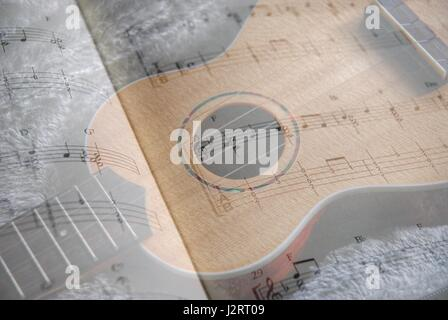 Ukulele and music, in tab and notation. Double exposure - Stock Photo