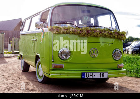 JURMALA, LATVIA - JULY 5, 2013: Green old VW bus decorated for celebration. - Stock Photo