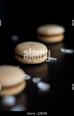 Macaroons with chocolate cream decorated with pebbles - Stock Photo