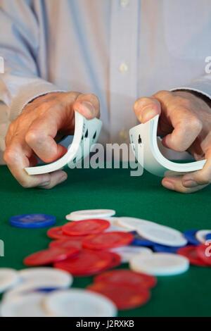Man Shuffling Cards at Poker Game - Stock Photo