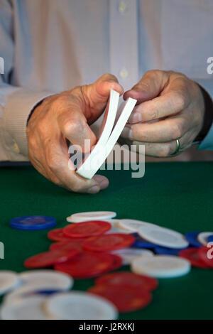 man Shuffling Cards Dealing at Poker Game - Stock Photo