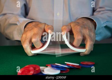 Man Shuffling Cards Dealing at Poker Game, USA - Stock Photo