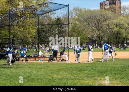 Softball Game on the Great Lawn Ballfields in Central Park, NYC, USA - Stock Photo