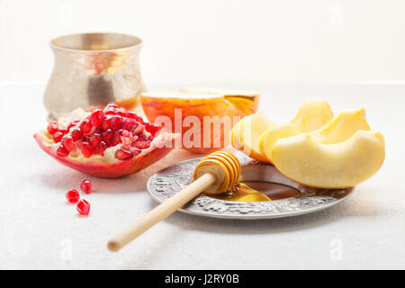 Apples, pomegranate and honey for Rosh Hashanah  - Stock Photo