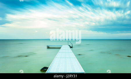 Pier in ocean - Stock Photo