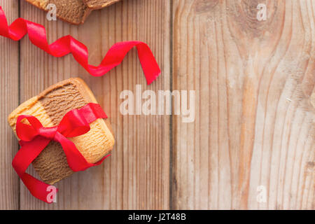Homemade cookies with a bow. copy space - Stock Photo