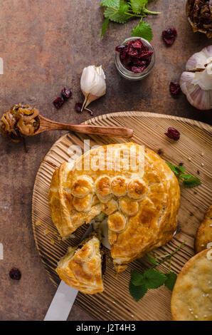 Puff pastry stuffed by camembert and berries, delicious food - Stock Photo