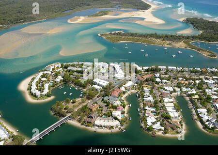 SEASIDE RESORT NEAR A COLORFUL ESTUARY (aerial view). Noosa Heads, Sunshine Coast, Queensland, Australia. - Stock Photo