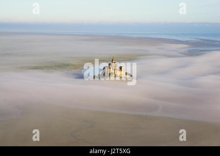 ABBEY ON A ROCKY ISLAND IN AN INTERTIDAL ZONE (aerial view). Mont Saint-Michel, Normandy, France. - Stock Photo