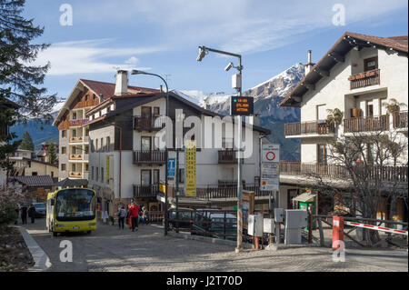 A local bus and accomodation in Sauze d'Oulx ski resort, Turin, Piedmont, Italy - Stock Photo