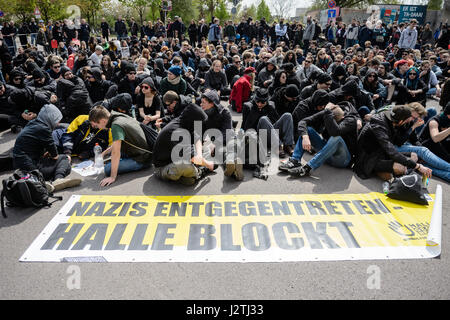 Halle, Germany. 01st May, 2017. Participants with a sign that reads 'Nazis entgegentreten - Halle blockt' (lt.'Nazis - Stock Photo